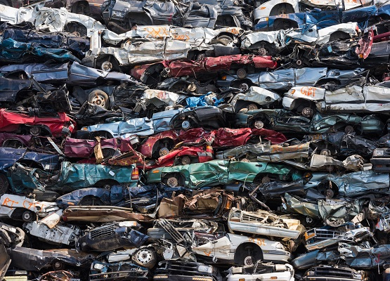 Crushed cars stacked up for recycling
